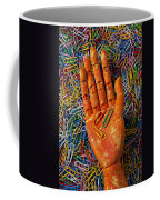 Orange Wooden Hand Holding Paperclips Coffee Mug
