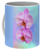 Orchid Delight - Two Blooms Against A Rainbow Background Coffee Mug