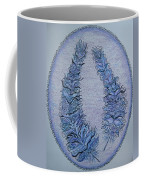 Oval With Two Tangled Feathers Coffee Mug