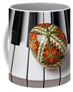 Painted Easter Egg On Piano Keys Coffee Mug by Garry Gay