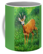 painting of young deer in wild landscape with high grass. Eye contact. Coffee Mug