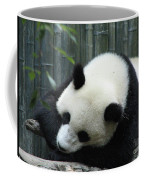 Panda Bear Sleeping On A Fallen Tree Branch Coffee Mug
