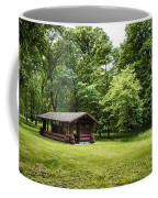 Park Shelter In Lush Forest Landscape Coffee Mug