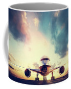 Passenger Airplane Taking Off On Runway At Sunset Coffee Mug