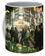 Pedestrians Cross A Crowded Tokyo Coffee Mug by Justin Guariglia