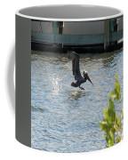 Pelican On The Waves Coffee Mug