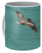 Pelican With His Wings Extended Over The Tropical Aruban Waters Coffee Mug