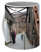 People Crossing Old Yugoslav Weathered Metal Bridge Crossing In Bosnia Hercegovina Coffee Mug