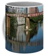 Picturesque View Of The Railroad Graffiti Bridge Over Lady Bird Lake As Canoes And Kayakers Paddle Under The Bridge On A Beautiful Summers Day Coffee Mug