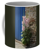 Pink Hollyhocks Growing From A Crack In The Pavement Coffee Mug