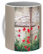 Poppies Against Wall Coffee Mug