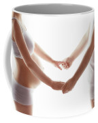 Pregnant Woman Holding Hands With A Man. Coffee Mug