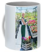 Professional Gardener At Work In A Nursery. Coffee Mug