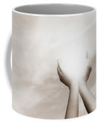 Raised Hands Catching Sun On Cloudy Sky. Concept Of Spirituality, Wellbeing, Positive Energy Coffee Mug