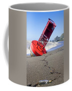 Red Bell Buoy On Beach With Bottle Coffee Mug