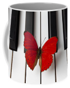 Red Butterfly On Piano Keys Coffee Mug