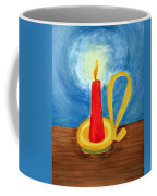Red Candle Lighting Up The Dark Blue Night. Coffee Mug