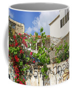 Red Flowers On A Wall Coffee Mug