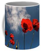 Red Poppies On Blue Sky Coffee Mug