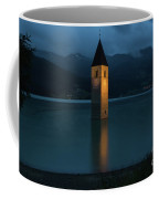Reschensee By Night Coffee Mug by Yair Karelic