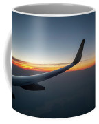 Right Wing Of Airplane In Mid Air With Sunrise In The Background Coffee Mug
