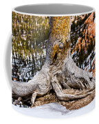 Roots Gripping The Edge Coffee Mug