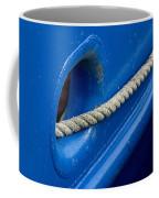 Rope Exiting Through The Bright Blue Coffee Mug
