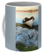 Row Boat On Shore Coffee Mug