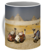 Scenic View Of The Giza Pyramids With Sitting Camels Coffee Mug