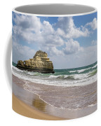 Sea Stack Sculpted Like A Ship Riding The Waves Coffee Mug