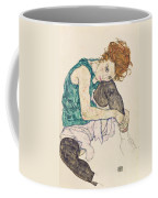 Seated Woman With Bent Knee Coffee Mug by Egon Schiele