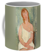 Seated Young Girl In A Shirt Coffee Mug