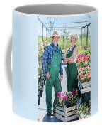 Senior Gardener And Middle-aged Gardener At Work. Coffee Mug