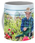 Senior Gardener Selecting A Tree. Coffee Mug