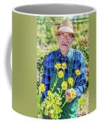 Senior Gardener Showing A Potted Flower. Coffee Mug