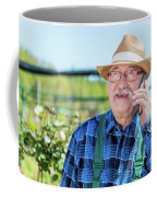 Senior Gardener Talking On The Phone With A Client. Coffee Mug