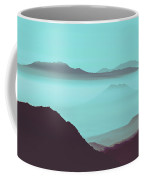 Serene Scene Of A Early Morning Misty Clouds Rolling Over The Rugged Mountainous Terrain Coffee Mug