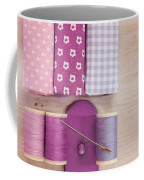 Sewing Threads Needle And Fabrics On A Wooden Box Coffee Mug