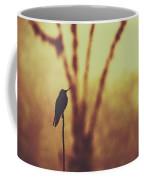 Silhouette Of A Hummingbird Against Golden Background, Mindo, Ecuador Coffee Mug