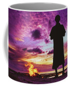 Silhouette Of A Local Man Standing By The Bonfire On The Beach In Maldives During Dramatic Sunset Coffee Mug