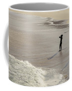 Silhouette On Beach Coffee Mug