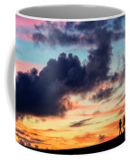 Silhouettes Of Three Girls Walking In The Sunset Coffee Mug