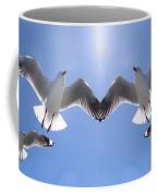 Six Heavenly Backlit Seagulls Flying Overhead In Blue Sky. Coffee Mug
