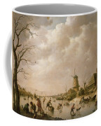 Skaters On A Frozen Canal Coffee Mug by Hendrik Willem Schweickardt