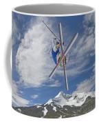 Skiing Aerial Maneuvers Off A Jump Coffee Mug by Gordon Wiltsie