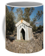 Small White Chapel On A Stone Wall Near Cres Coffee Mug
