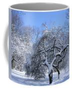 Snow-covered Sunlit Apple Trees Coffee Mug