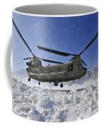 Snow Flies Up As A U.s. Army Ch-47 Coffee Mug