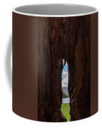 Spot The Lake Shore View Through The Hollow Tree Trunk Coffee Mug