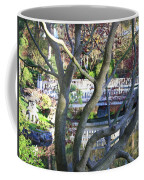 Springtime Bridge Through Japanese Maple Tree Coffee Mug by Carol Groenen